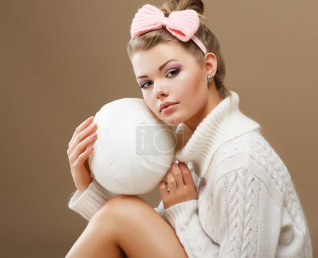 Photo for Hosiery. Beautiful Teen in Handmade Woven Sweater with White Ball of Yarn - Royalty Free Image