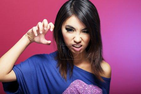 Negative Emotions. Expressive Asian Female Threatens