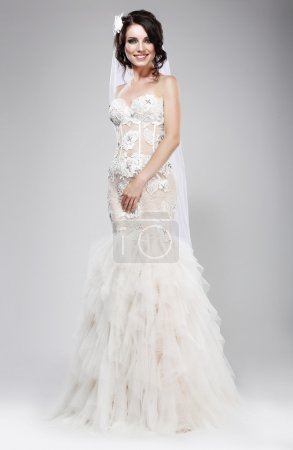 Wedding Style. Sophisticated Newlywed in White Bridal Dress. Elegance