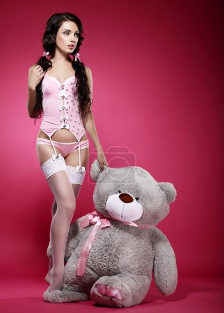 Fascinating Young Woman in Pink Lingerie with her Fondling - Soft Toy