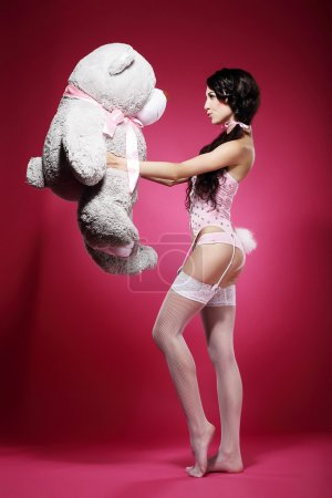 Voluptuous Woman in Tights and Garters with Big Soft Toy