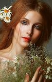 Pure Beauty. Auburn Girl holding Bouquet of Wildflowers. Tenderness