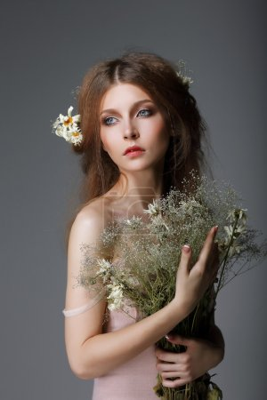 Photo for Sentimentality. Redhaired Affectionate Muse with Flowers in Dreams - Royalty Free Image