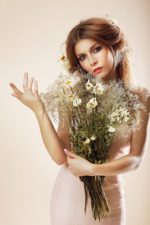 Simplicity. Elegant Graceful Woman with Bouquet of Flowers posing in Studio