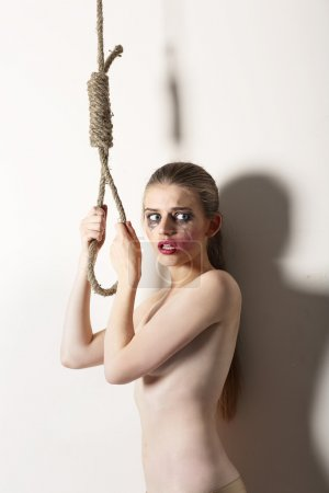 Violence. Unhappy Bizarre Woman Hipster Self-Murder with Noose of Rope