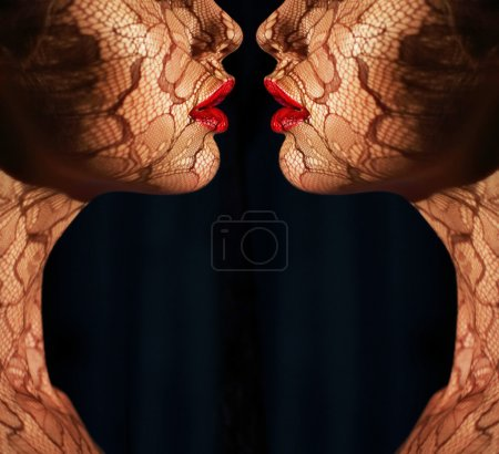 Fantasy. Two Women's Faces with Tracery Opposite each other. Reflexion