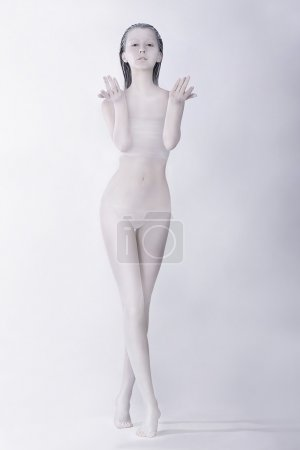 Fantasy. Surreal Bodypainting. Styled Artistic Woman Colored White. Creative Art