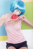 Beautiful Dreamy Woman in Blue Wig Holding Slice of Watermelon