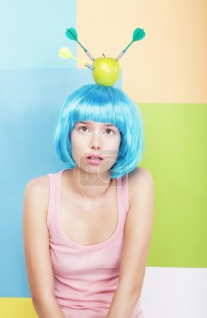 Stylized Woman with Apple on her Blue Haired Head. Series of Photos