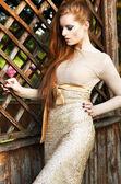 Character. Charismatic Auburn Woman in Elegant Dress