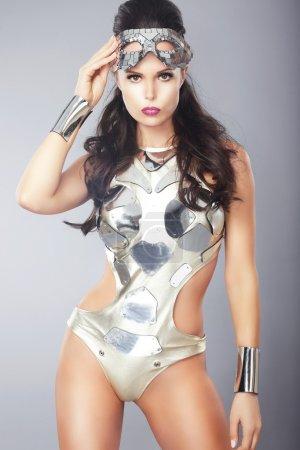 Splendor. Ultramodern Woman with Metallic Mask in Trendy Costume