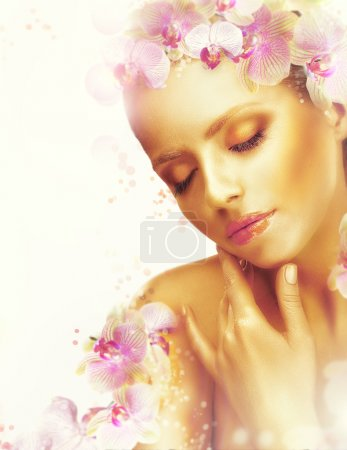 Photo for Complexion. Gorgeous Woman with Perfect Bronzed Skin and Orchid Flowers. Fragrance - Royalty Free Image