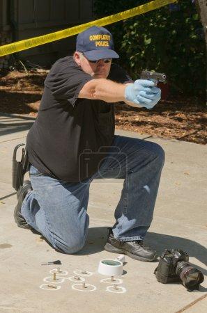 Detective with pistol