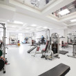 Interior of new modern gym with equipment...