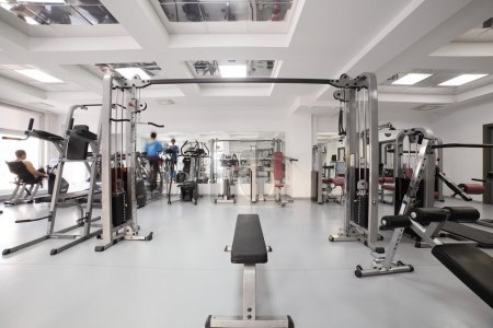 Photo for Interior of new modern gym with equipment - Royalty Free Image