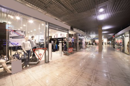 Photo for Modern interior and windows in fashionable shopping mall - Royalty Free Image