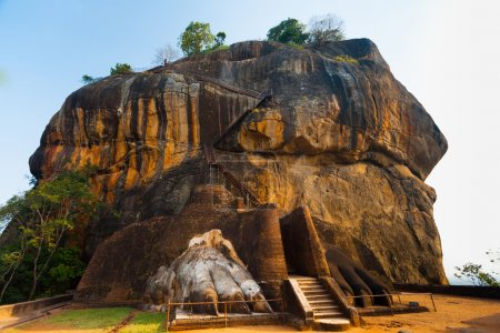 Photo for The second level stairs and entrance to the former fortress and monastery of Sigiriya rock, guarded by a pair of lion feet in Sri Lanka - Royalty Free Image