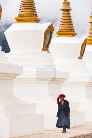 Tibetan Woman Walking Large Chortens Stupas Deqin