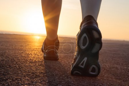 Photo for Running shoes with sunset beyind - Royalty Free Image