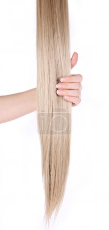 Blonde hair extensions in female hand isolated on white