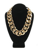 gold necklace chain on velvet stand isolated on white background, fashion jewelry