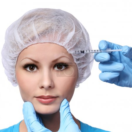 Botox injection in beautiful female face isolated on white. Brow zone. Closeup