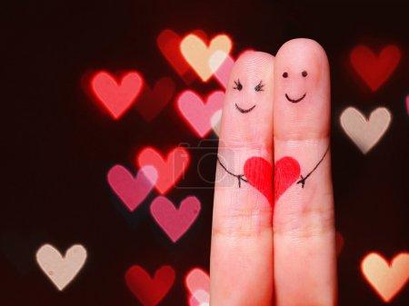 Photo for Happy Couple Concept. Two fingers in love with painted smiley faces and heart over bokeh background - Royalty Free Image
