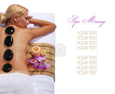 Spa Stone Massage. Beautiful Blonde Getting Hot Stones Massage