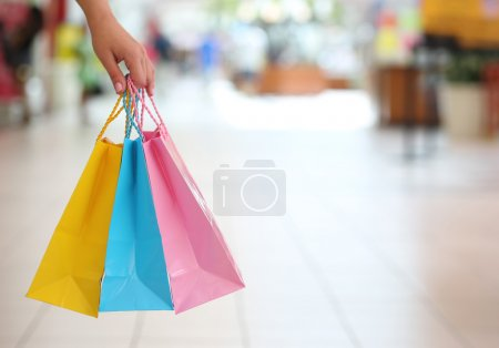 Shopping! Female Hand Holding Colorful Shopping Bags in Shopping
