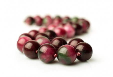 pink agate beads isolated
