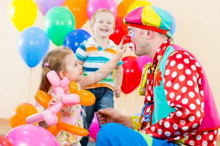 Happy children and clown on birthday party