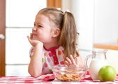 Kid girl refuses to eat healthy food