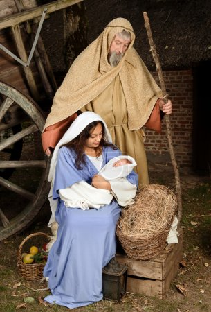 Photo for Live Christmas nativity scene reenacted in a medieval barn - Royalty Free Image