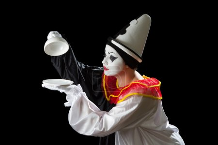 Surprised Pierrot clown uncovering an empty tray d...