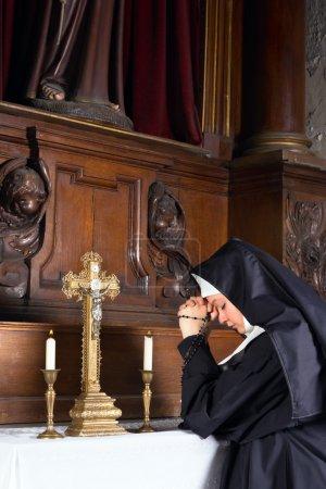 Nun in chapel
