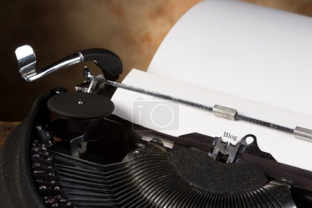 Photo for Antique typewriter with an empty page and the word BLOG - Royalty Free Image