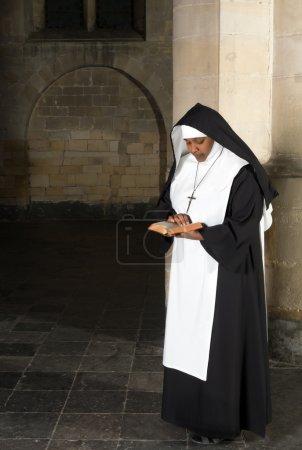 Reading nun in habit