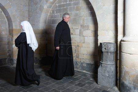 Nun passing priest