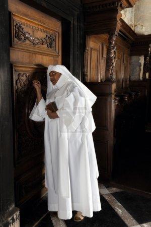 Nun knocking on door