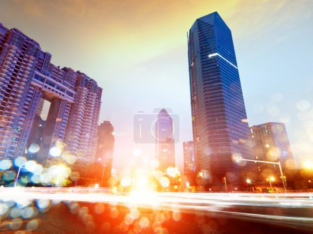 Photo for The light trails on the modern building background in shanghai china. - Royalty Free Image