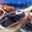 Freeway in night with cars light in modern city....