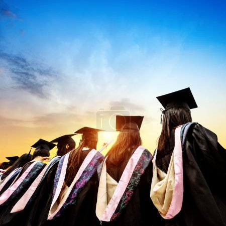 Photo for Graduates face the morning sun - Royalty Free Image
