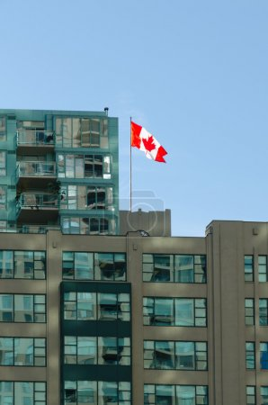 Canadian flag on roof of building...