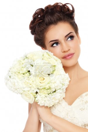 Photo for Portrait of young beautiful bride with stylish make-up and hairdo looking upwards, over white background - Royalty Free Image