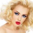 Young beautiful woman with blond curly hair and stylish make-up, over white background