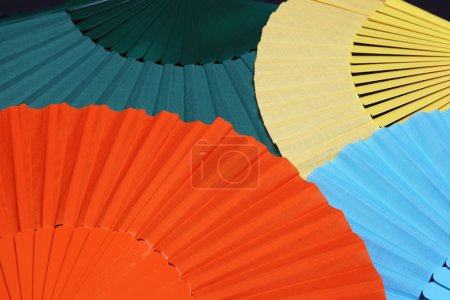 Photo for Background of four colorful flamenco fans, selective focus - Royalty Free Image