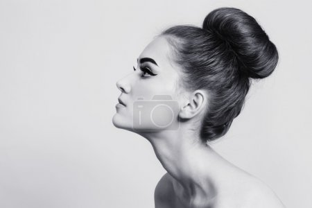 Photo for Black and white shot of young beautiful girl with hair bun - Royalty Free Image