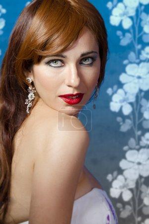 Beautiful redhead on blue vintage background
