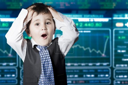 Surprised businessman child in suit with funny face, stock marke