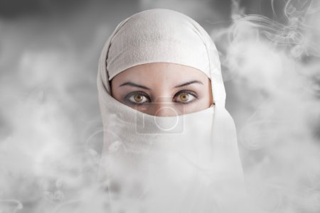 Arabic woman into smoke clouds